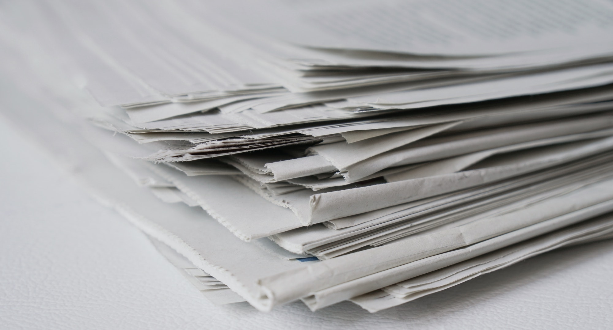 close-up of a pile of newspaper as a news and media concept